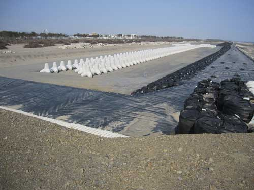Figure 12. Repaired defences and the tetrapods that will form part of the new defences.